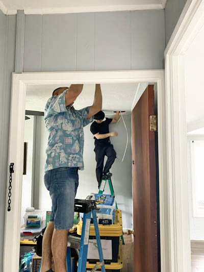 this picture shows an electrician wiring a new home